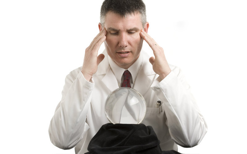 doctor looking into crystal ball