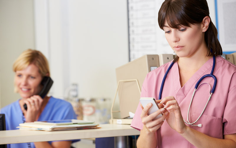 Nurse making staffing adjustments from her phone